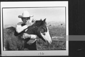 Horse trainer Tom Dorrance, 83, gently holding arms around neck of young horse. (Photo by Acey Harper/The LIFE Images Collection via Getty Images/Getty Images)